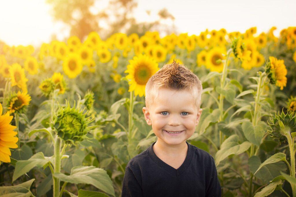 child, sun, sunflowers